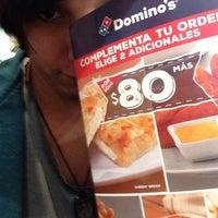 Foto tomada en Dominos pizza por Beto R. el 12/14/2015