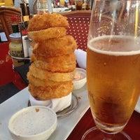 Foto diambil di 5 Napkin Grill oleh Rosaura O. pada 11/25/2012