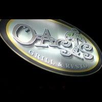 Foto diambil di Oasis Bar and Grill oleh Dimple C. pada 12/26/2012