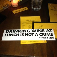 Photo taken at Postino Winecafé by C W. on 5/25/2013