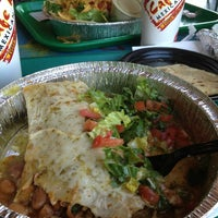 Photo taken at Cafe Rio Mexican Grill by Michael J. on 1/1/2013