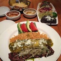 Photo taken at Cantina Laredo by yuna l. on 3/6/2013