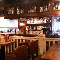 Photo taken at Lebowski Bar by Stefan E. on 3/3/2013