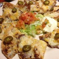 Foto diambil di Chili's Grill & Bar Restaurant oleh Adrian O. pada 1/28/2013