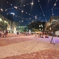 Photo taken at Federation Square by Sarah B. on 2/23/2013