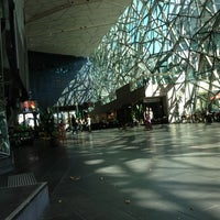 Photo taken at Federation Square by Aravind S. on 2/12/2013