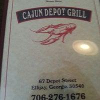Das Foto wurde bei Cajun Depot Grill von DeAdrin R. am 6/1/2013 aufgenommen
