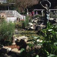 Photo taken at Myrtle Creek Botanical Gardens & Nursery by Tess H. on 2/3/2014