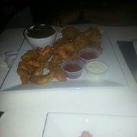 Foto tomada en Pearl Restaurant and Lounge por 《《Lamont》》 el 9/17/2014