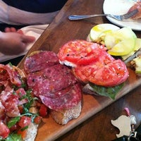 Photo taken at Postino Winecafé by J'Sin P. on 7/14/2012