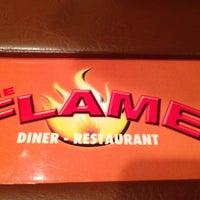 Foto scattata a The Flame Restaurant da Ray W. il 7/5/2013