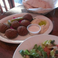 Photo taken at Afrah Mediterranean Restaurant & Pastries by Amy B. on 8/1/2012