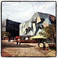 Photo taken at Federation Square by Jordan A. on 7/8/2012