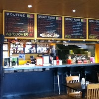 Photo taken at La Belle Patate by Vivianne C. on 4/9/2012