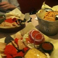 Foto diambil di Mickie Finnz Fish House & Bar oleh Mike D. pada 2/29/2012