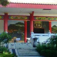 Photo taken at Vihara Buddha Sasana by Tin-tin S. on 8/19/2012