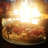 Photo taken at Woodstock's Pizza by Shawn H. on 8/22/2012