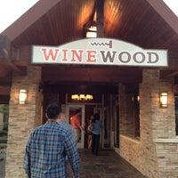 Foto diambil di Winewood Grill oleh Angela W. pada 9/12/2012