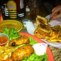 Снимок сделан в Hurricane's Bar & Grill пользователем Christina H. 4/11/2012
