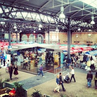 Photo taken at Old Spitalfields Market by Jim P. on 7/21/2012