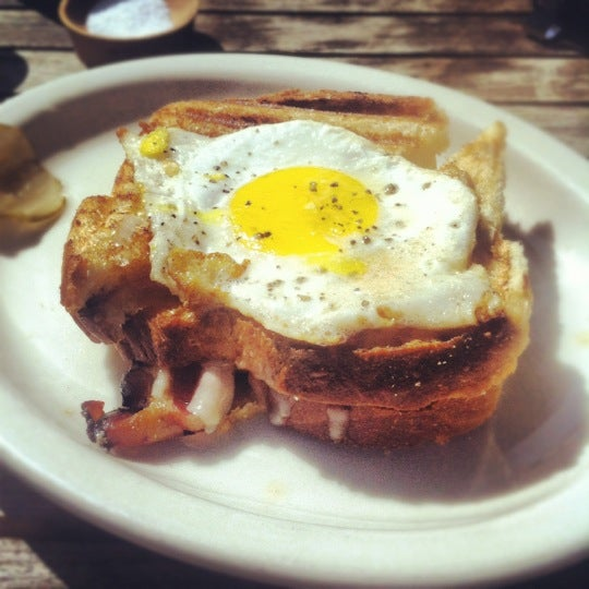 Grilled Cheddar Cheese w/ bacon & maple syrup, topped w/ a fried egg.    Brunch doesn't get any better than this.