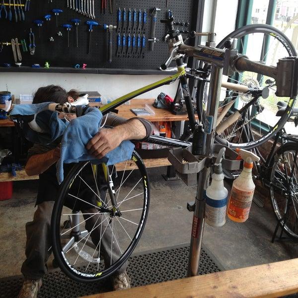 Photo taken at Denver Bicycle Cafe by Tim J. on 5/5/2013