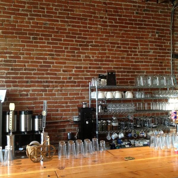 Photo taken at Denver Bicycle Cafe by Tim J. on 5/20/2013