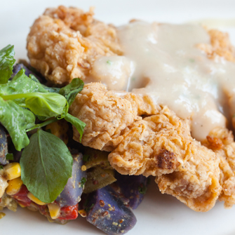 Chef Danny Trace offers the Chicken-fried 'Lot 42' cauliflower steak as part of his two-course, $25 Farmer's Corner menu at lunch, as well as part of his $80 six-course vegetable dinner.
