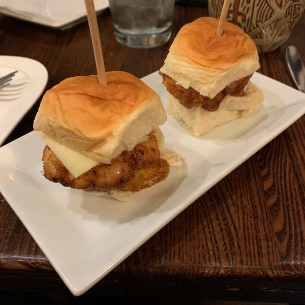 Cuban chicken sliders - mojo battered chicken breast, bacon aioli, Monterey Jack cheese, and crispy plantains. #sanctuaria #24hourfoodgeek Follow us at http://24hourfoodgeek.com