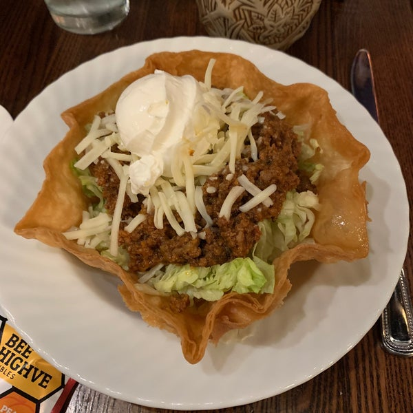 Taco salad - seasoned ground beef, house salsa, tomato, lettuce, jack cheese, and sour cream in a flour tortilla shell. #sanctuaria #24hourfoodgeek Follow us at http://24hourfoodgeek.com