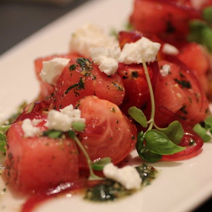 New. Mediterranean/Italian restaurant. There is a raw bar, a charcuterie and cheese bar and a menu that includes gazpacho, a watermelon salad, fettuccine with lobster, diver scallops.