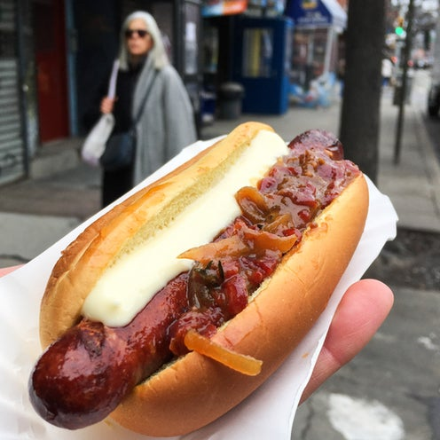 The Basque Dogs ($8.50) at Huertas is made with chistorra sausage (pork and paprika) and slathered with both a smooth white aioli and a chunky, sweet, and tangy piquillo mostardo sauce.