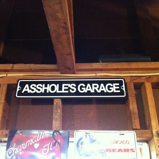 Assholes garage metal sign