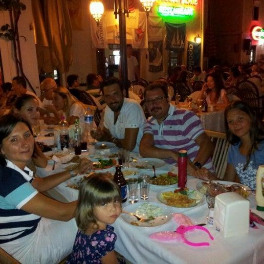 Foto scattata a Neighbours Restaurant da Erhan S. il 7/14/2012