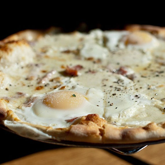 Their breakfast pizza is oozes richness - with cream, pancetta, provolone, mozzarella, two perfect eggs, and cracked black pepper.