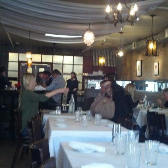 Foto scattata a Los Olivos Wine Merchant Cafe da Derek B. il 2/17/2014