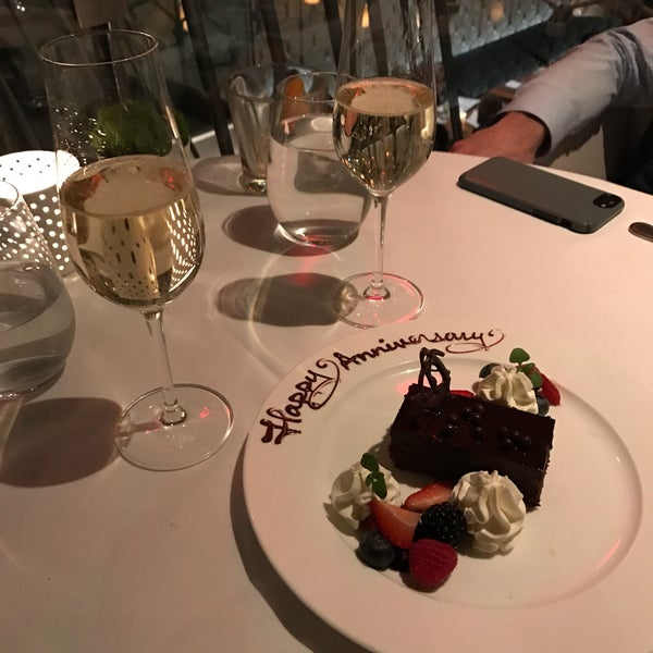 Seven different staff members wished us a happy anniversary. Brought a smile to our faces. Complementary dessert/champagne. Gave us bag with special menus/candle/small bottle of champagne. AMAZING!