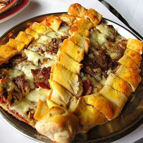 Happy Hump Day! How about a Karisik Pide for a great mid week dinner? ‪#‎TacisBeyti‬ Karisik Pide- a pide made with sauteed ground lamb, turkish sausage, pastrami & mozzarella cheese