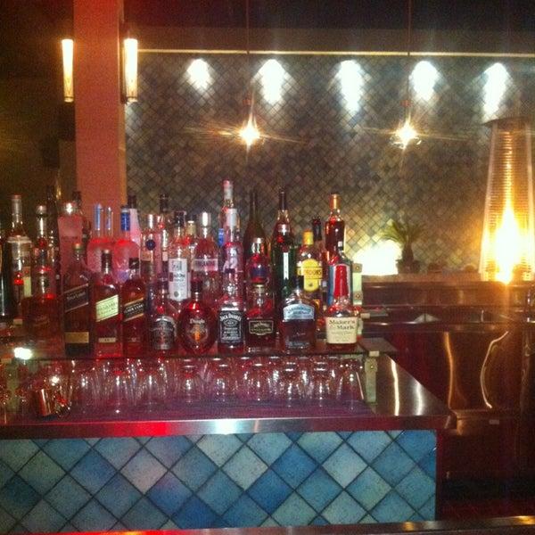 Start off at the bar upstairs. Bueno