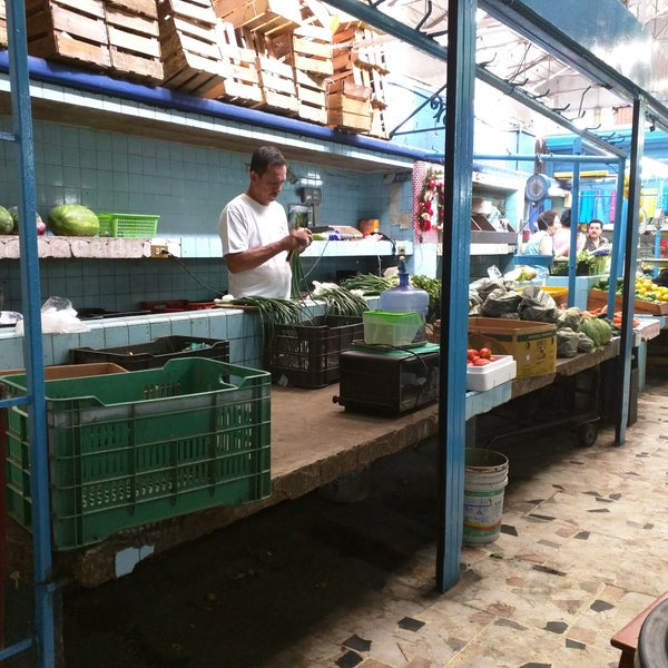 A huge indoor market with stalls for fruit and vegetables, fresh fish, meats, and also a section for clothes and tourist souvenirs.