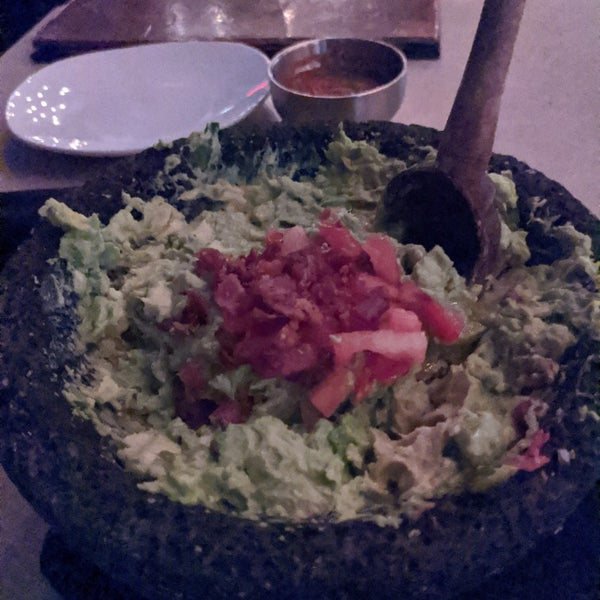 Table side guacamole, hatch Chile infused tequila, atmosphere and outside seating.