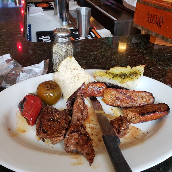 Steak tips and sausage plate with hot cherry peppers and grilled bread.. My favorite!!