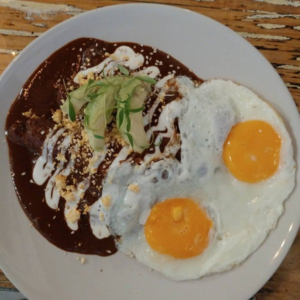Chicken enchiladas with mole and eggs on the side! Yum!