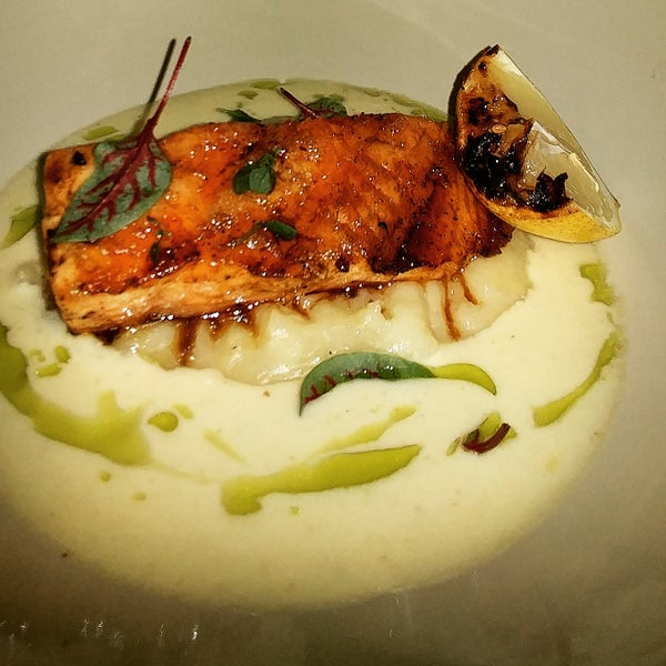 Order the seared salmon with pureed potatoes and charred lemon.