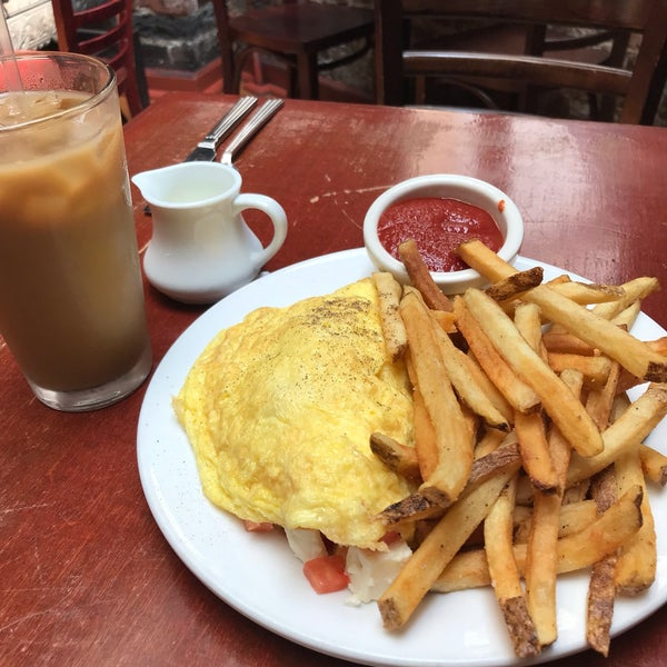 Come for the heaping plate of fries, stay for the quiet red-brick corner to read with a coffee.