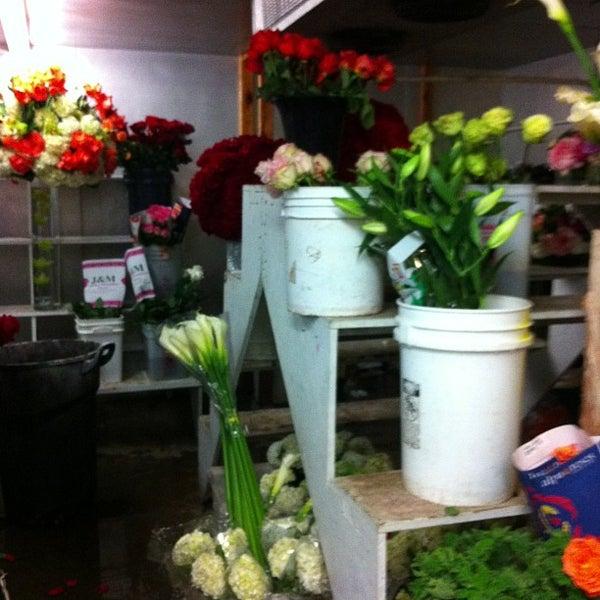 Photo taken at La Premier Flowers by Mark E S. on 10/11/