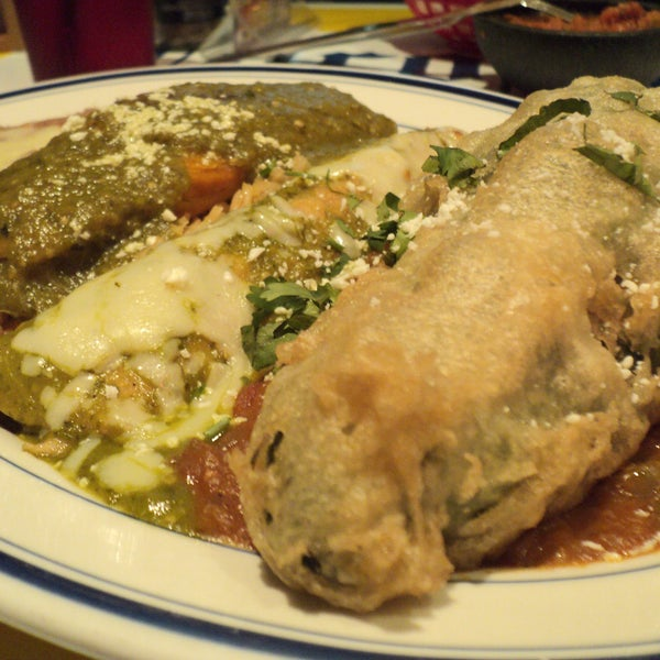"Looks better on TV's Unique Eats - ""Chingo Bling"" - A smoked chicken stuffed Poblano pepper dish with an enchilada and a tamale. See video here at: http://www.ulive.com/video/houstons-finest-tex-mex"