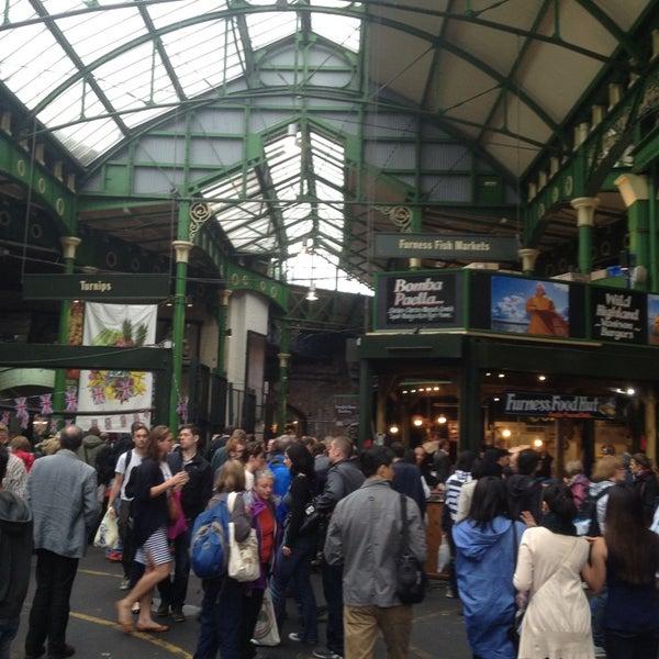 Foto tirada no(a) Borough Market por Kelly D. em 6/28/2013