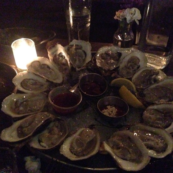 Great service, hip/trendy vibe, and delicious authentic, all natural food. HH drinks only available at the bar but HH oysters available for dining room. Their cocktails are also fabulous.