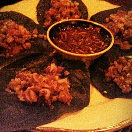 Betel leaf wrapped dried shrimp, ginger and mint with chili dipping sauce.So good!